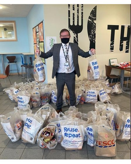 Acting head of school at Pakefield High School, Dan Bagshaw, arranging the delivery offood parcels to support families