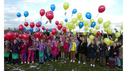 Rainbows, Brownies, Guides and Guiders releasing balloons at Trimley St Martin Primary School in 2005