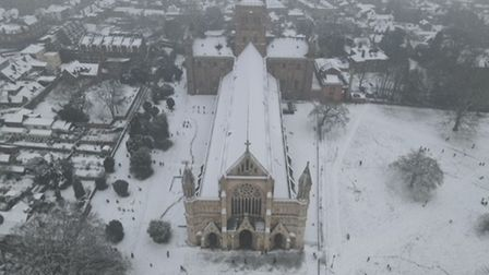 An aerial shot of St Albans Cathedral in the snow