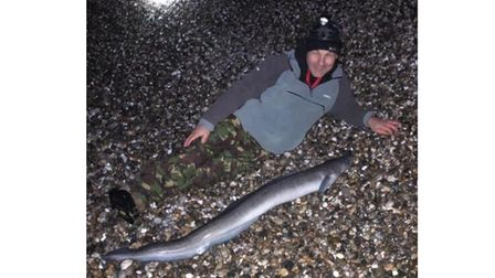 Liam with a beach-caught conger