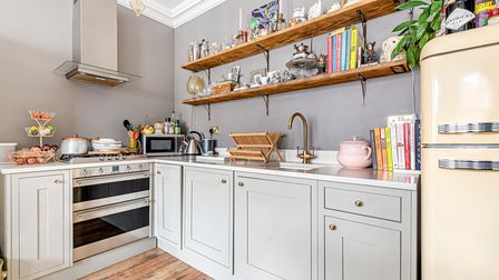 Built in appliances including a Beko washing machine and an oven, hob and extractor fan which are all SMEG.