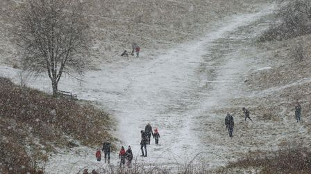 Families on Therfield Heath madethe most of the snow on Sunday