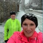 Willow Gibson and Gill Soll of Garden City Runners out in the snow.
