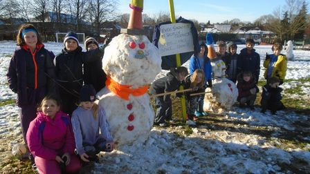 The children of two key worker bubbles at Skyswood Primary had great fun in the snow today (Monday), making'socially...