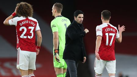 Arsenal manager Mikel Arteta (centre) celebrates with his players after the Premier League match at