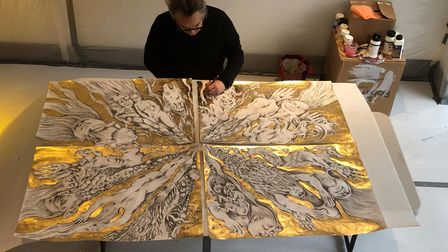 David Breuer-Weil working on one of his Golden Drawings