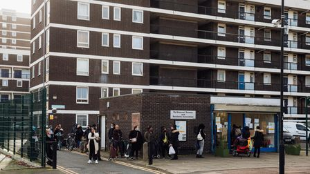 People line up outside a Hackney estate.