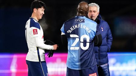 Wycombe Wanderers' Adebayo Akinfenwa in discussion with Tottenham Hotspur's Son Heung-min (left) and