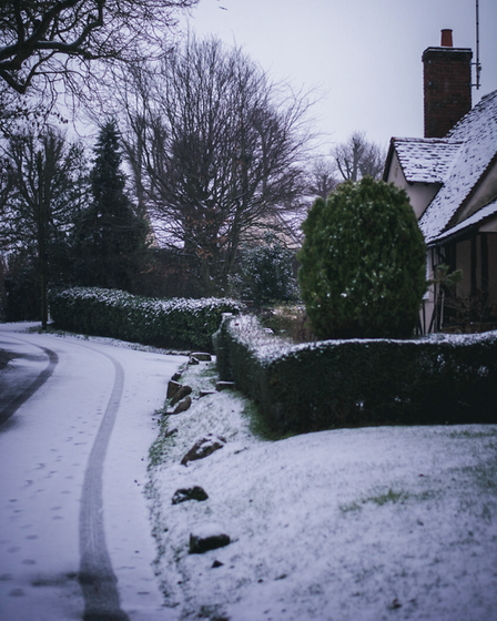 Elsenham house and street covered in snow