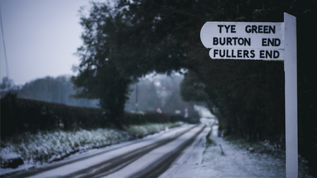 Road sign in snowy Elsenham