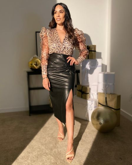 Forever Unique founder Seema Malhotra in a stylish leather skirt and leopard print top