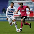 Queens Park Rangers' Chris Willock (left) and Derby County's Graeme Shinnie battle for the ball duri