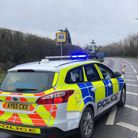 The westbound lane of the A146 Beccles Road, near to The Crown pub, has been closed following a hydraulic fluid spill.