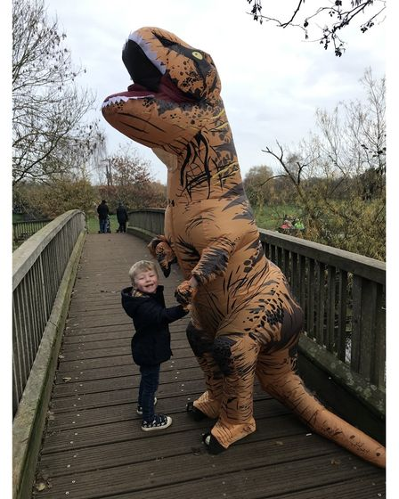 Toddler with giant dinosaur
