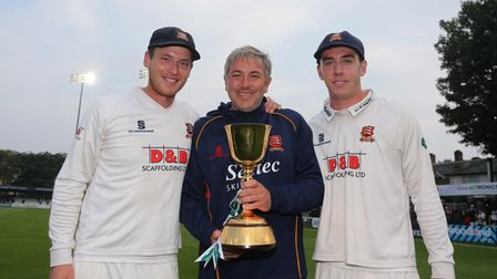 Tom Westley (L), Chris Silverwood and Daniel Lawrence with the County Championship Trophy during Ess