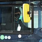 File photo dated 24/03/20 of a London bus driver wearing a face mask and gloves. Bus drivers in Lond