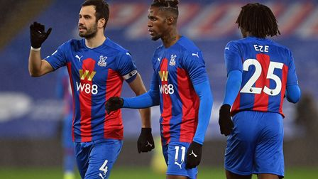 Crystal Palace's Wilfried Zaha (centre) celebrates scoring their side's first goal of the game with
