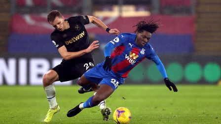Crystal Palace's Eberechi Eze (right) and West Ham United's Tomas Soucek battle for the ball during