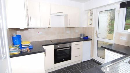 The kitchen is fitted with an extensive range of wall and floor cupboards and drawers