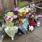 Flowers are laid in tribute to Romaria Opia, 15, who was stabbed in Holland Walk,  on the Elthorne Estate in Archway