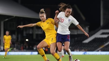 England Women's Lucy Staniforth and Australia Women's Steph Catley (left) battle for the ball during