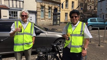 Cllrs John Crockford-Hawley and James Tonkin on their bikes in Axbridge. Picture: John Crockford-Haw
