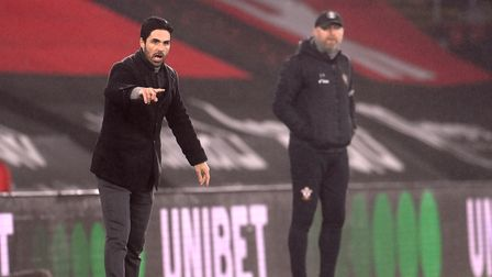 Arsenal manager Mikel Arteta and Southampton manager Ralph Hasenhuttl (background) on the touchline