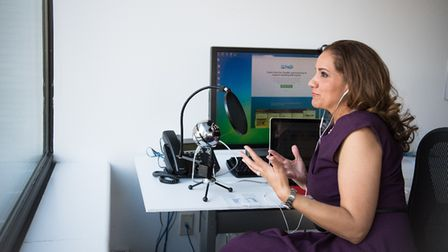 A woman recording a podcast