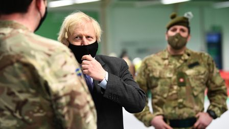 Prime minister Boris Johnson meets troops setting up a vaccination centre in the Castlemilk district of Glasgow on his one...