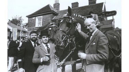 Patrick Cobbold, right, at the Woolpack pub in 1990 with landlord Peter Lockwood and groom Tony Moore