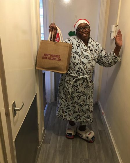 Sabelo with her carefully packed Christmas lunch.