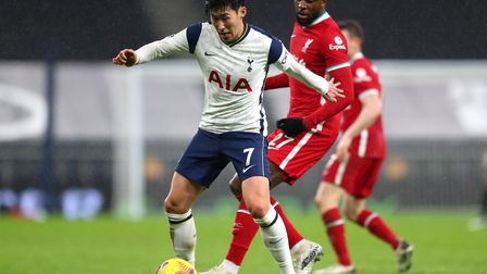 Tottenham Hotspur's Son Heung-min (left) and Liverpool's Divock Origi battle for the ball during the