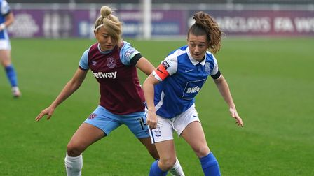 Birmingham City's Christie Murray and West Ham United's Cho So-hyun (left) battle for the ball durin