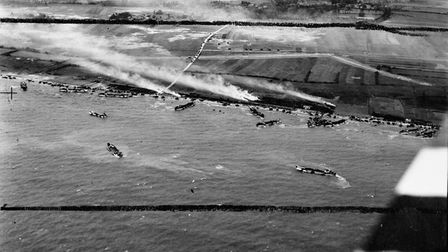 The Normandy beach under attack during the D-Day landings.