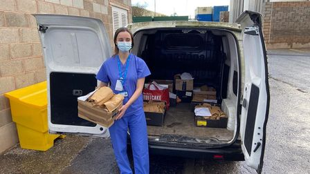 A Nightingale nurse takes delivery of donated gift bags