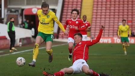 Przemyslaw Placheta of Norwich and Mads Juel Andersen of Barnsley in action during the FA Cup match