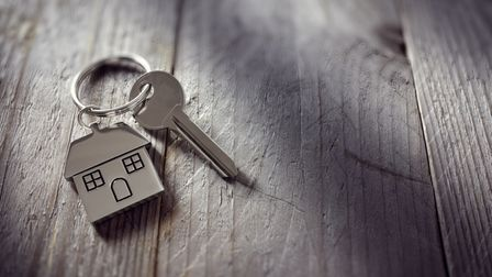 House key on a house shaped keychain