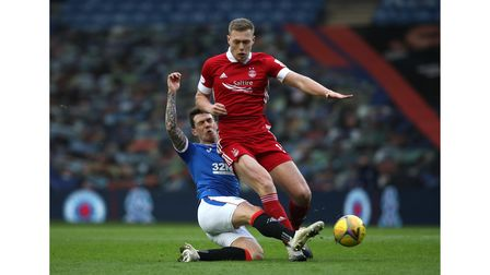 Aberdeen's Sam Cosgrove (right) and Rangers' Ryan Jack battle for the ball during the Scottish Premi