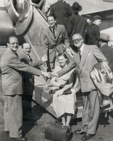 Aaltje and Dennis Berry in the middle, with members of the Dutch Songwriter's Guild about to board a plane.