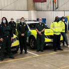Jamie Secker from CPFT with colleagues and a team fromthe East of England Ambulance Service
