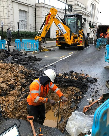 Workmen tackling the burst water main in Chequer Street.