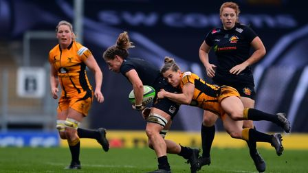 Kate Zackary of Exeter Chiefs Women is tackled by Claudia MacDonald of Wasps Women during the Women'