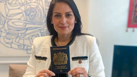 Home Secretary Priti Patel holding a blue passport. Photograph: Home Office/PA Wire.