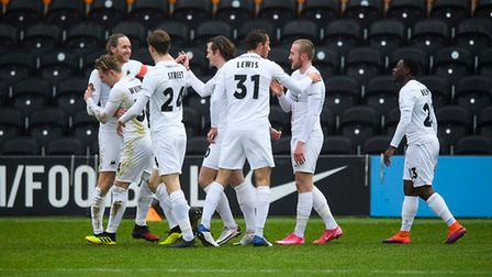 GOAL! Ben Whitfield of Torquay United celebrates with his teammates having scored to break the deadl