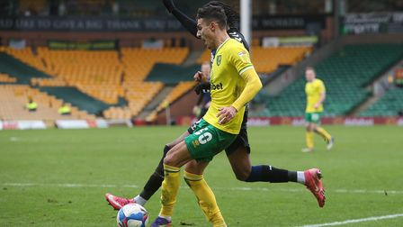 Dimitris Giannoulis of Norwich and Djed Spence of Middlesbrough in action during the Sky Bet Champio