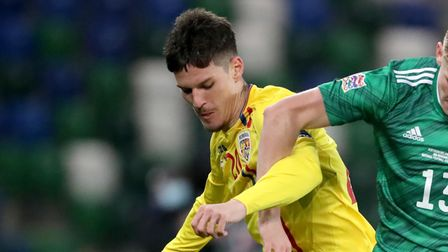 Romania's Dennis Man (left) and Northern Ireland's Alistair Mccann battle for the ball during the UE