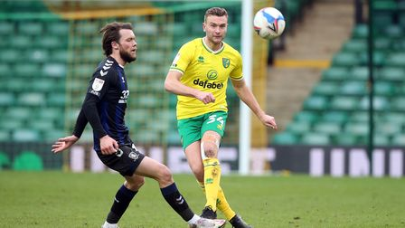 Jonathan Howson of Middlesbrough and Ben Gibson of Norwich in action during the Sky Bet Championship