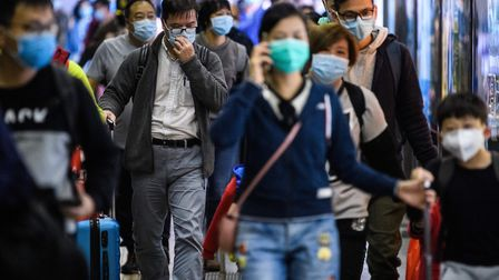 Passengers wear protective face masks as they arrive from Shenzhen to Hong Kong. Picture: ANTHONY WA