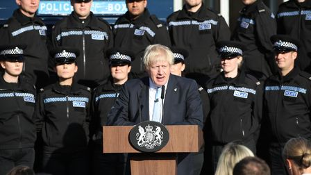 Boris Johnson delivers a speech in front of police officers in West Yorkshire. Photograph: Danny Law