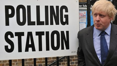 Boris Johnson leaves a polling station after casting his vote in an election. Photograph: Ian Nichol